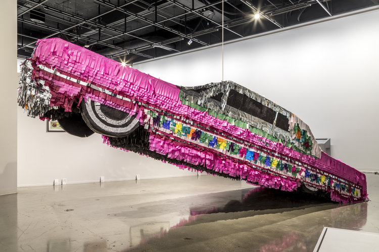 Gypsy Rose Piñata. 2017. Found objects, cardboard, styrofoam, paper and glue. 5'x19.5'x6.5′ Photo: Courtesy the artists and Petersen Automotive Museum