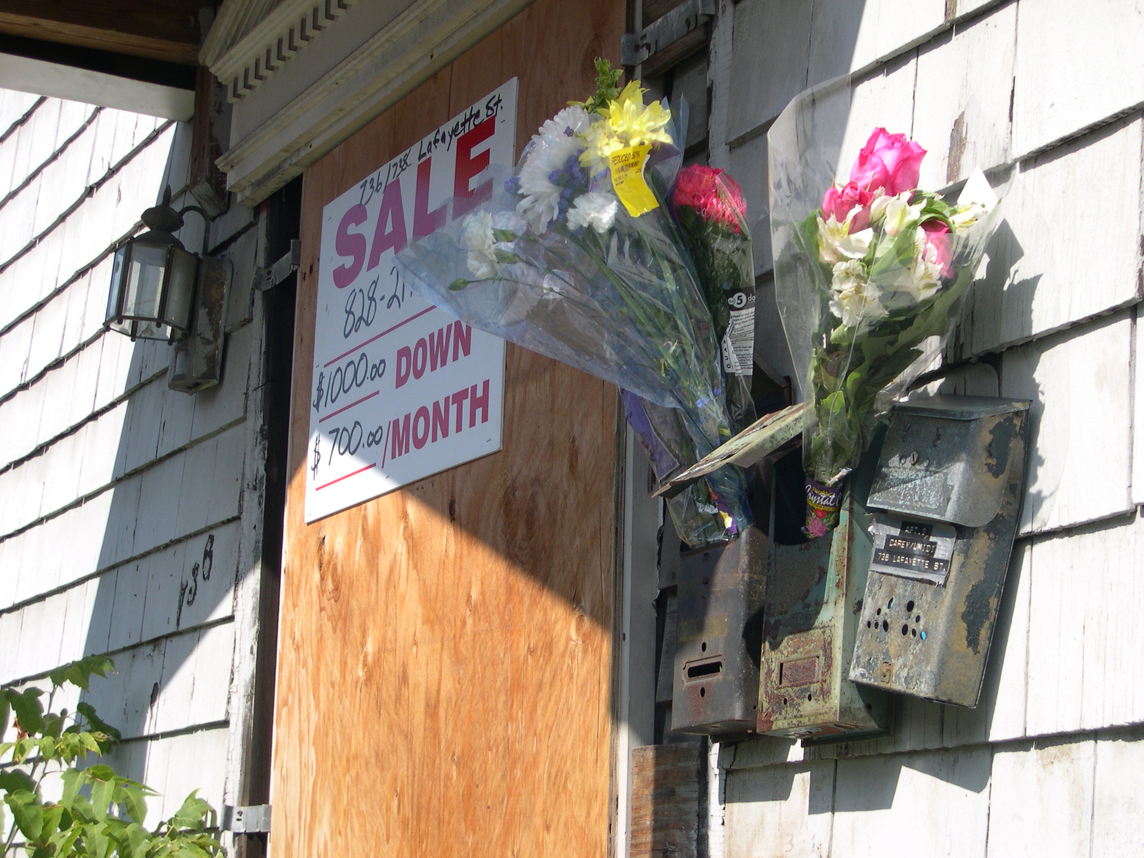 Reduced for Quick Sale , 2004; Discounted bouquets delivered to the boarded up houses that surround an upstate New York artists residency.