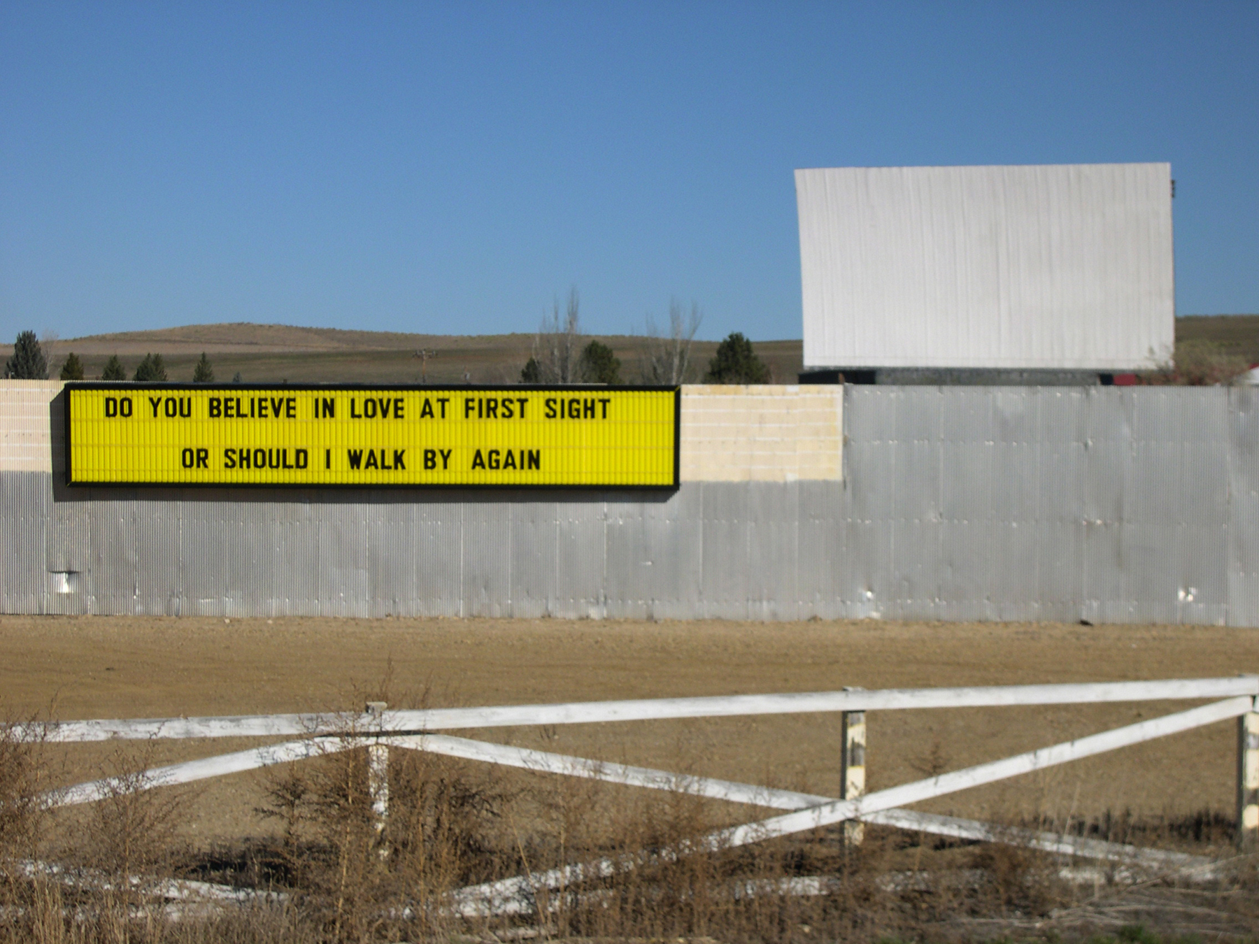 Sheridan Line , 2004, marquee text, Sky Line Drive-In Theater, Sheridan, WY; A pick-up line addressed to the Great Plains from Sheridan's closed-for-the winter drive-in theater. All images courtesy the artist.