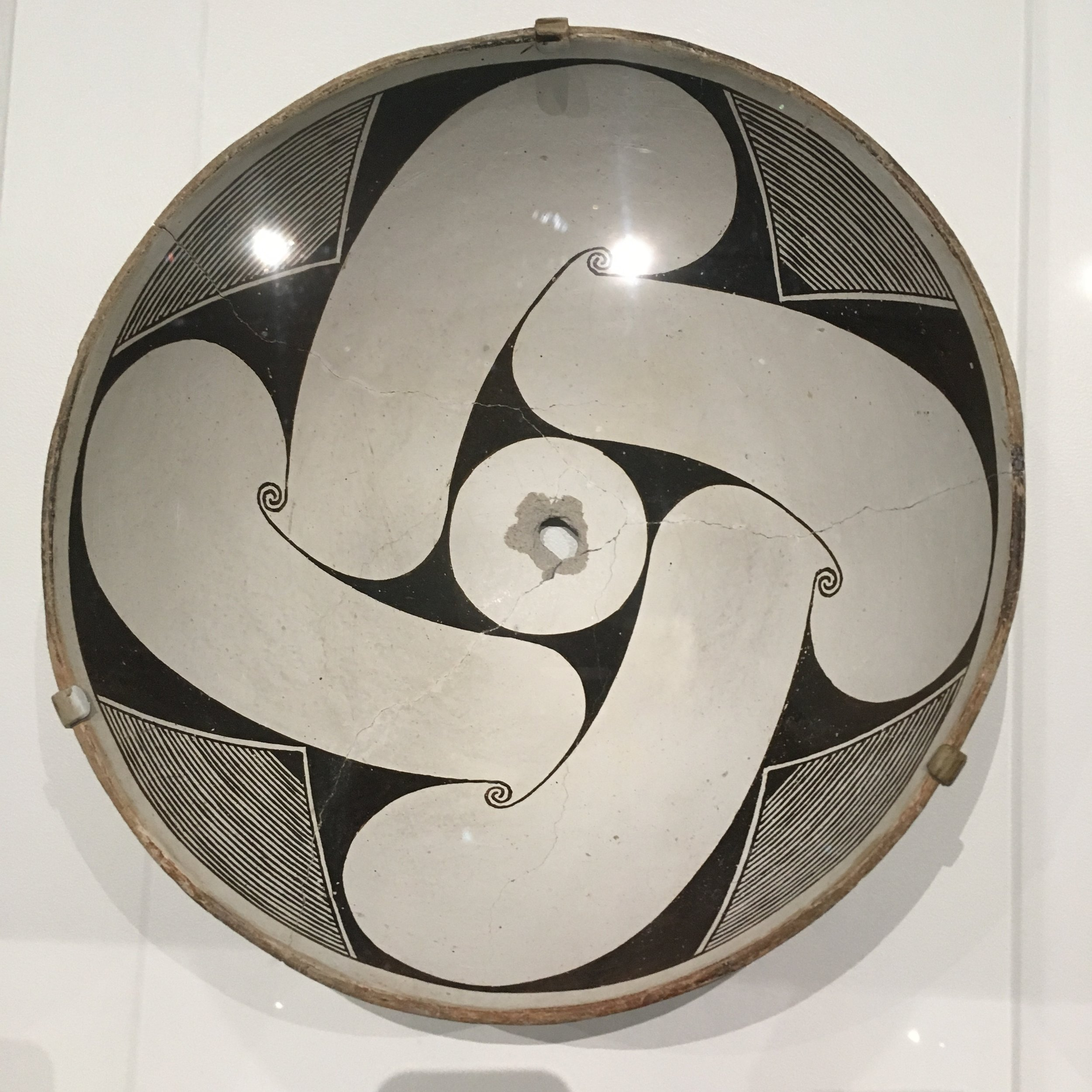 Bowl With Abstraction of Unfurling Datura Bud , from  Decoding Mimbres Painting: Ancient Ceramics of the American Southwest , at LACMA. Photo D.K. Sole.