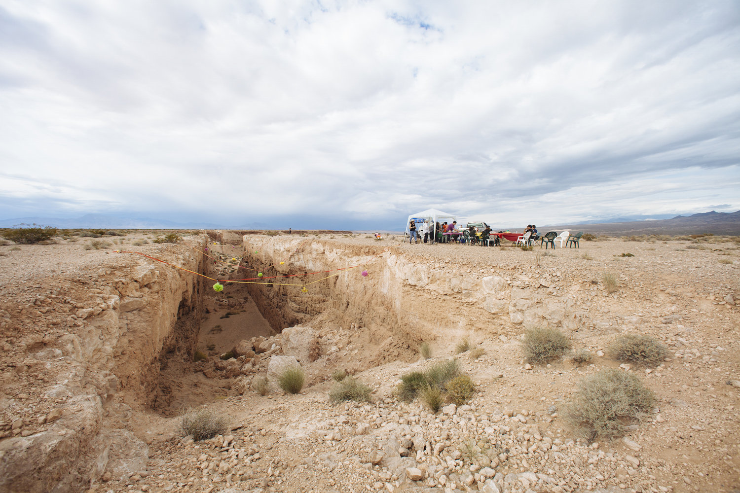 Justin Favela's  Family Fiesta at Michael Heizer's Double Negative located in the Moapa Valley on Mormon Mesa near Overton, Nevada on May 9, 2015. Favela's video documenting the performance was included in the Nevada Museum of Art Tilting the Basin exhibition in Reno and Las Vegas. Justin is a past  Nevada Arts Council Artist Fellowship  recipient, and his work is on view in Justin Favela and Ramiro Gomez, Sorry For the Mess at the Marjorie Barrick Museum of Art; in a solo exhibition, All You Can Eat, at the Houston Center for Contemporary Craft (opens June 1); and Birth, Death and Regeneration at the The Museum of Art and History at the McPherson Center, Santa Cruz, CA (July-October). Image courtesy the artist and Nevada Museum of Art, photo credit Mikayla Whitmore.