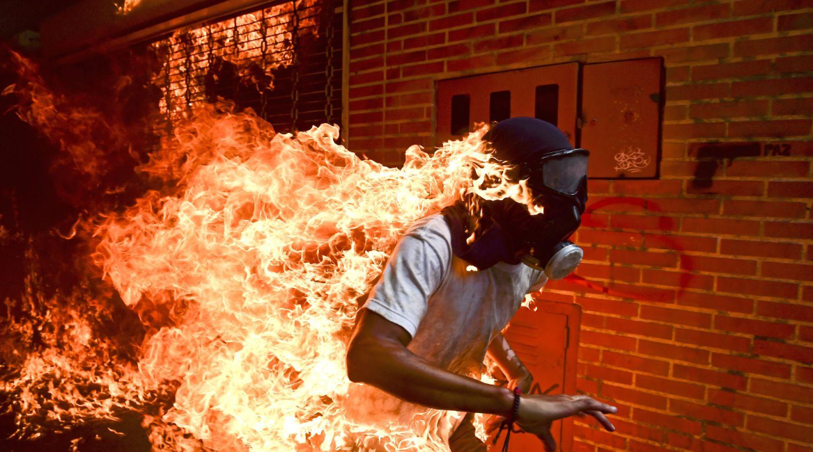 Venezuela Crisis   José Víctor Salazar Balza (28) catches fire amid violent clashes with riot police during a protest against President Nicolás Maduro, in Caracas, Venezuela.