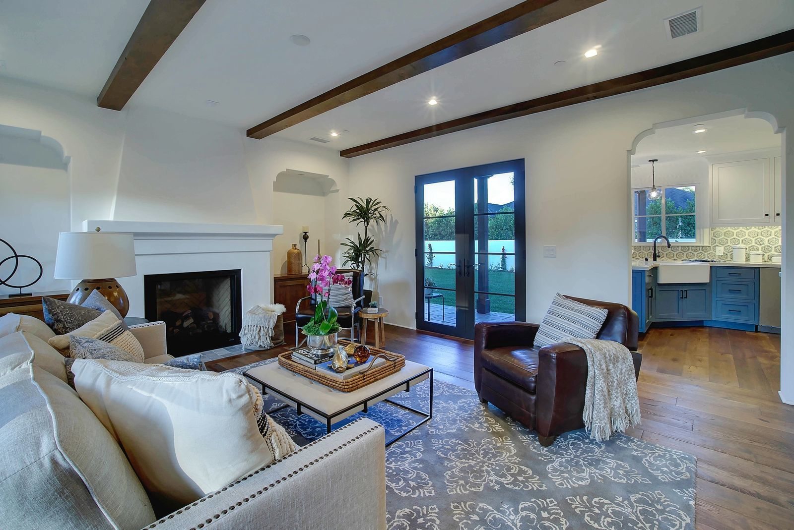 Spanish-revival-living-room-fireplace-premier-general-contractors.jpg