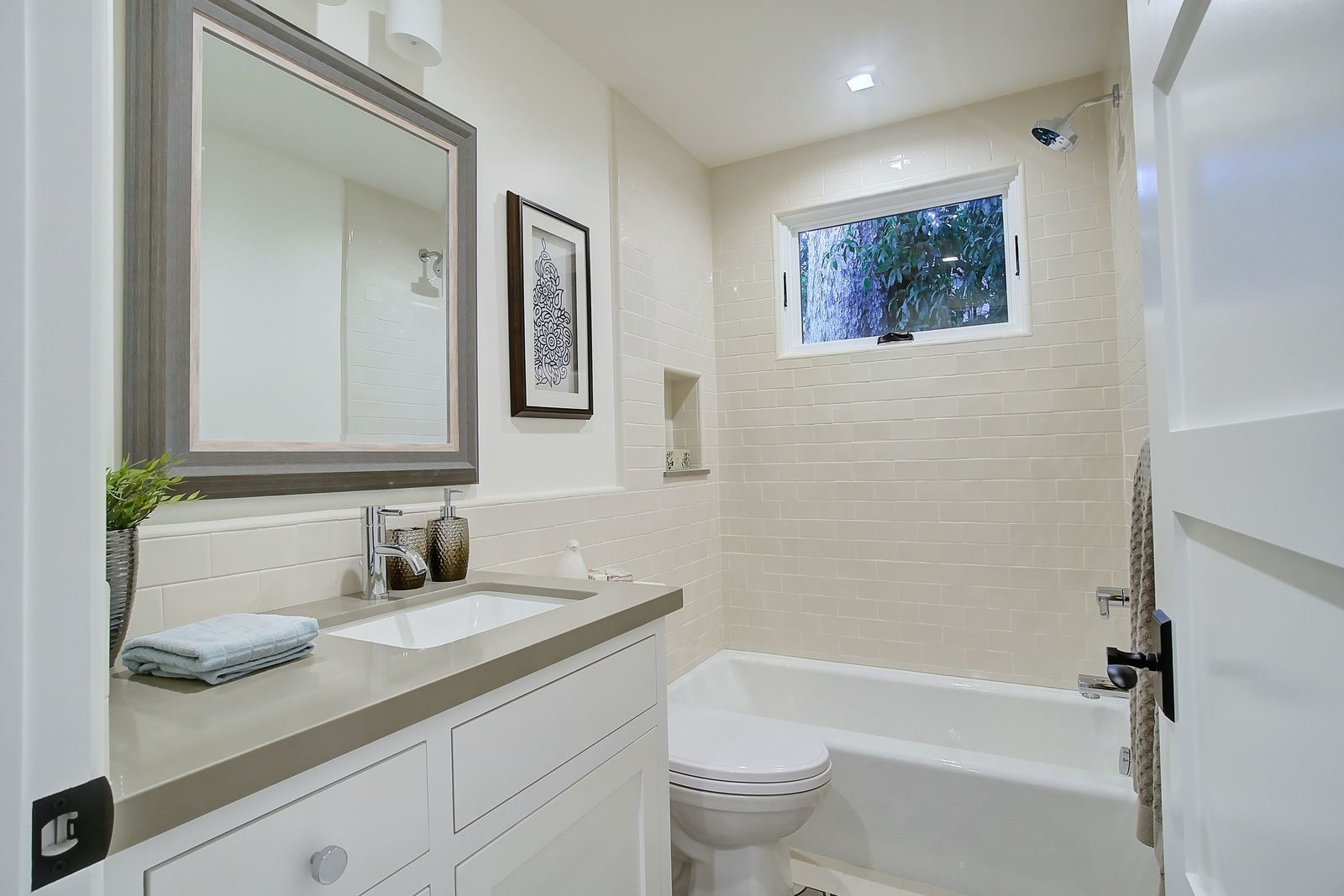 contemporary-spanish-bathroom-tile-tub-shower-premier-general-contractors.jpg