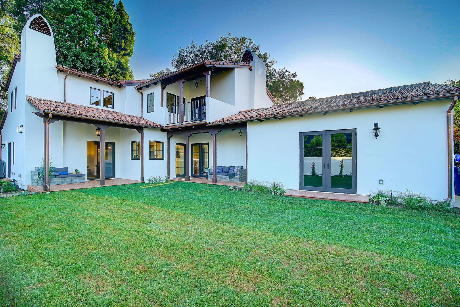 modern-spanish-revival-rear-exterior-steel-windows-premier-general-contractors.jpg