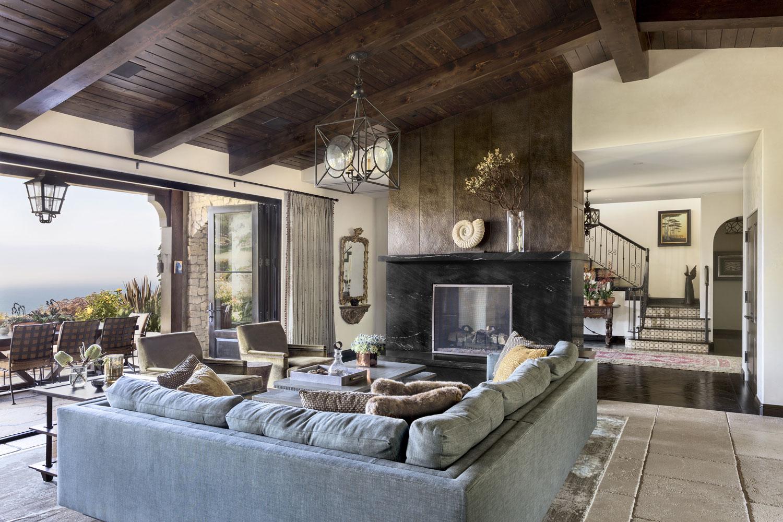 living-room-retractable-window-dual-sided-fireplace-premier.jpg