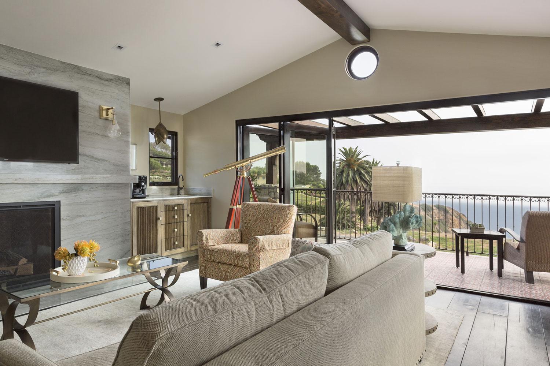 living-room-vaulted-beamed-ceiling-marble-fireplace-premier.jpg