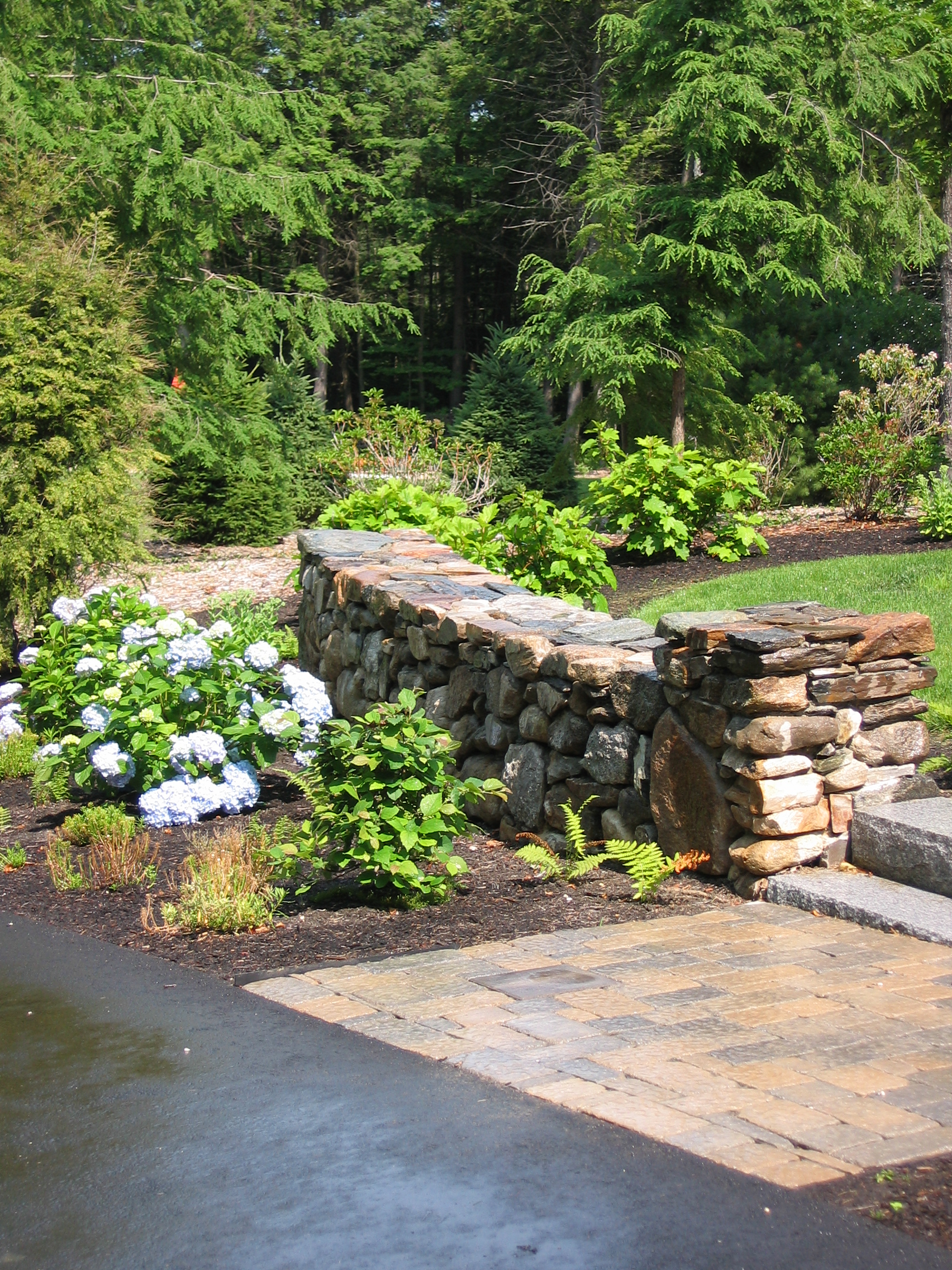 Stonewall with fieldstone.JPG
