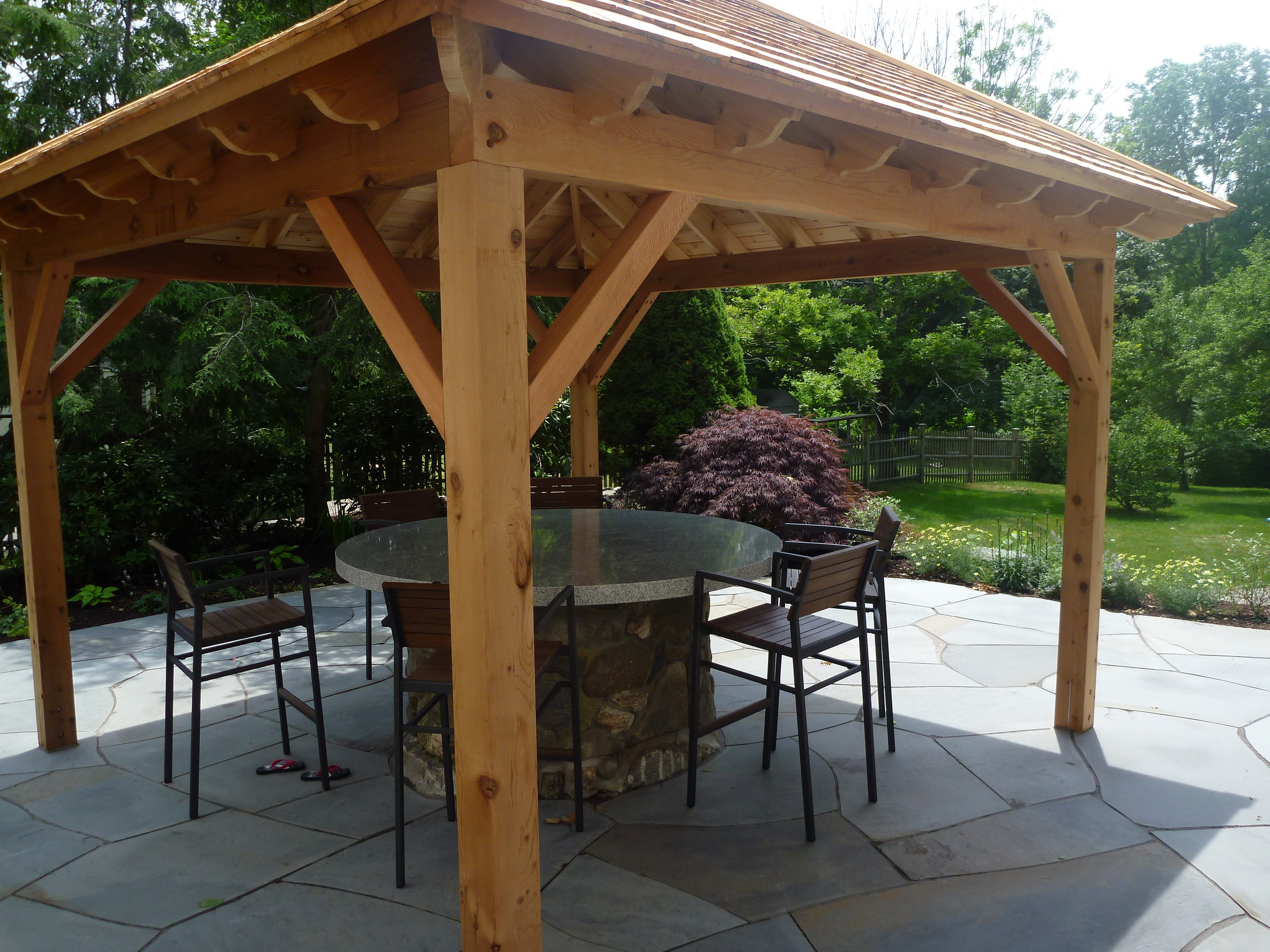 Cedar Pergola with Woodbury Granite Table Top on Well.jpg