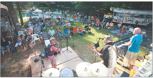 A crowd of about 100 people gathered to listen as Ludrock All-Star Barney Betka, backed up by the All-Star band, gets the crowd going during the show. -JEFF KIESSEL | DAILY NEWS PHOTOS