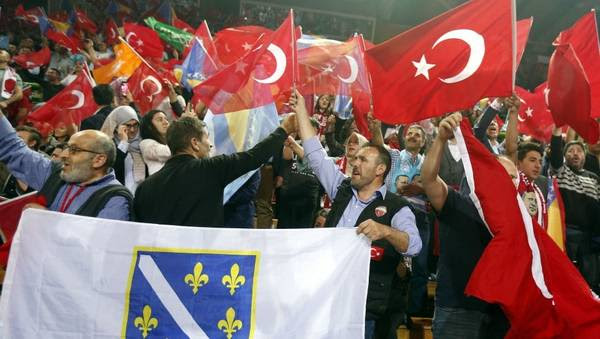 Supporters of Erdogan wave flags during the rally in Sarajevo on May 20. (Fehim Demir/EPA-EFE)