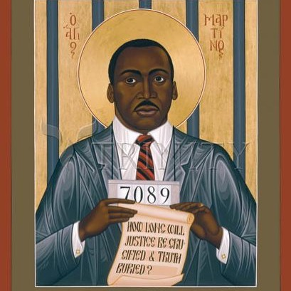 """This icon depicts Martin Luther King, one of the martyrs of the Twentieth Century. He was an ordained minister of the Baptist Church. From 1955 until his death, he led a campaign of nonviolent resistance in the United States against racial oppression and injustice. The number he wears around his neck is from a 'mug shot' taken one of the many times he was arrested by American police for resisting unjust laws. . The prison bars behind him represent the occasions he was placed in jail, and also the oppression and slavery of Afro-Americans in the United States. The text on his scroll is from his speech in Albany, Georgia, on December 14, 1961. The Greek inscription by his head reads, 'Holy Martin.' . . Since the eighteenth century, the faith of American American Christians in America has been tied to the struggle of freedom. Martin Luther King renewed the bond between faith and political action like the Old Testament prophets. Although his life was threatened many times, he continued to expose himself to danger. He was shot on April 4x, 1968, in Memphis, Tennessee."" . . . . . . #RumanProject #InterFaithDialogue #Islam #Christianity #Muslim #Christian #Bible #Scripture #Religion #MLK #BlackHistoryMonth  #BlackLivesMatter #BlackPower #BlackAndProud #EndRacism #AfricanAmerican #BlackUnity #Equality #HumanRights #Resistance #History #Justice #BlackOwned"