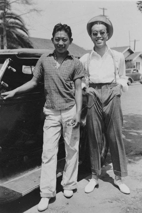 Mack Hori and George Shibata posing on Second Street next to a friend's car in 1937.  Gift of George Fujino, Japanese American National Museum