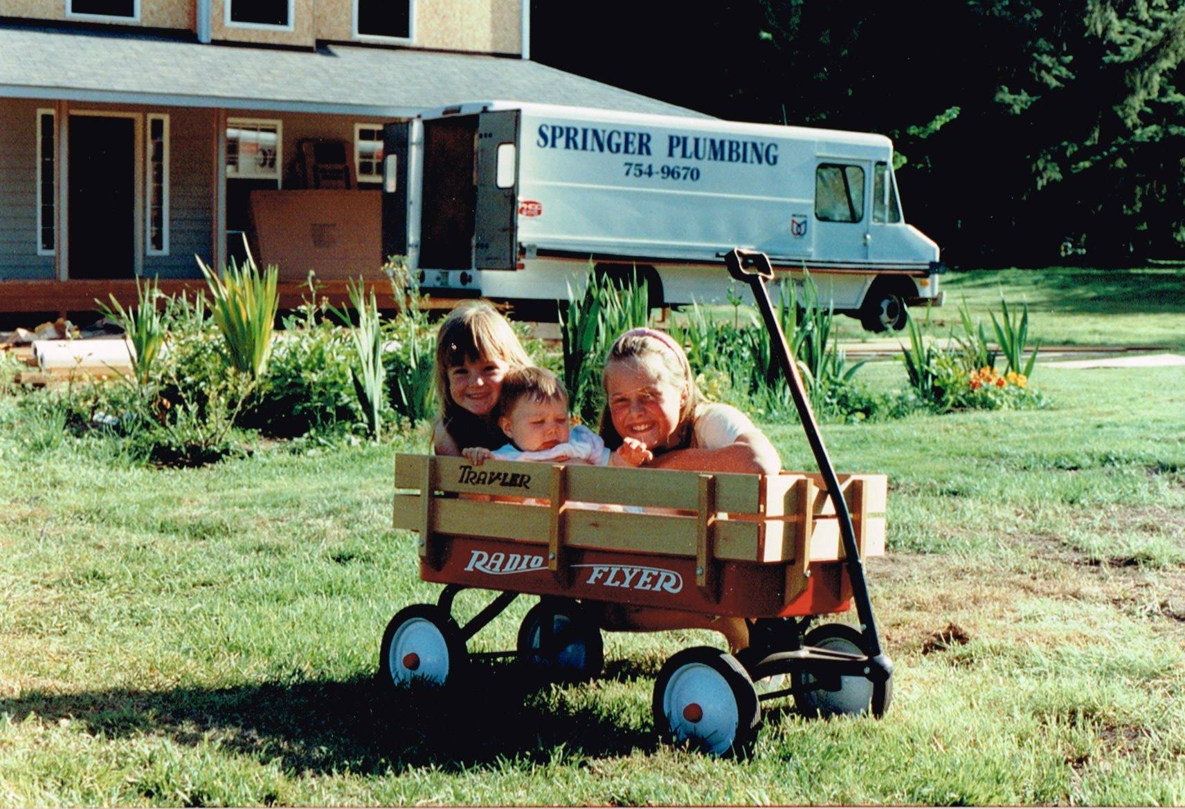 Ron & Diane's 3 daughters with one of their first plumbing vans in the background.