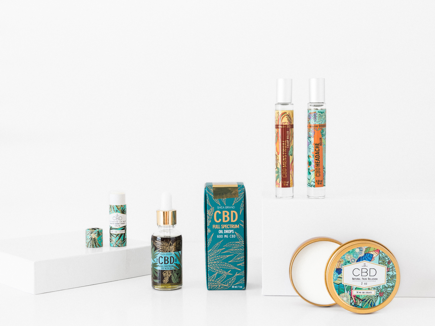 Voyage + Heart - Mail In Product Photography - Shea Brand - Product Photographers for Natural Skincare Lines - Shea Brand CBD Pain Reliever - Shea Brand CBD Mentstrual Roller - Shea Brand Headache Roller - E Commerce Photographers for Skincare Brands