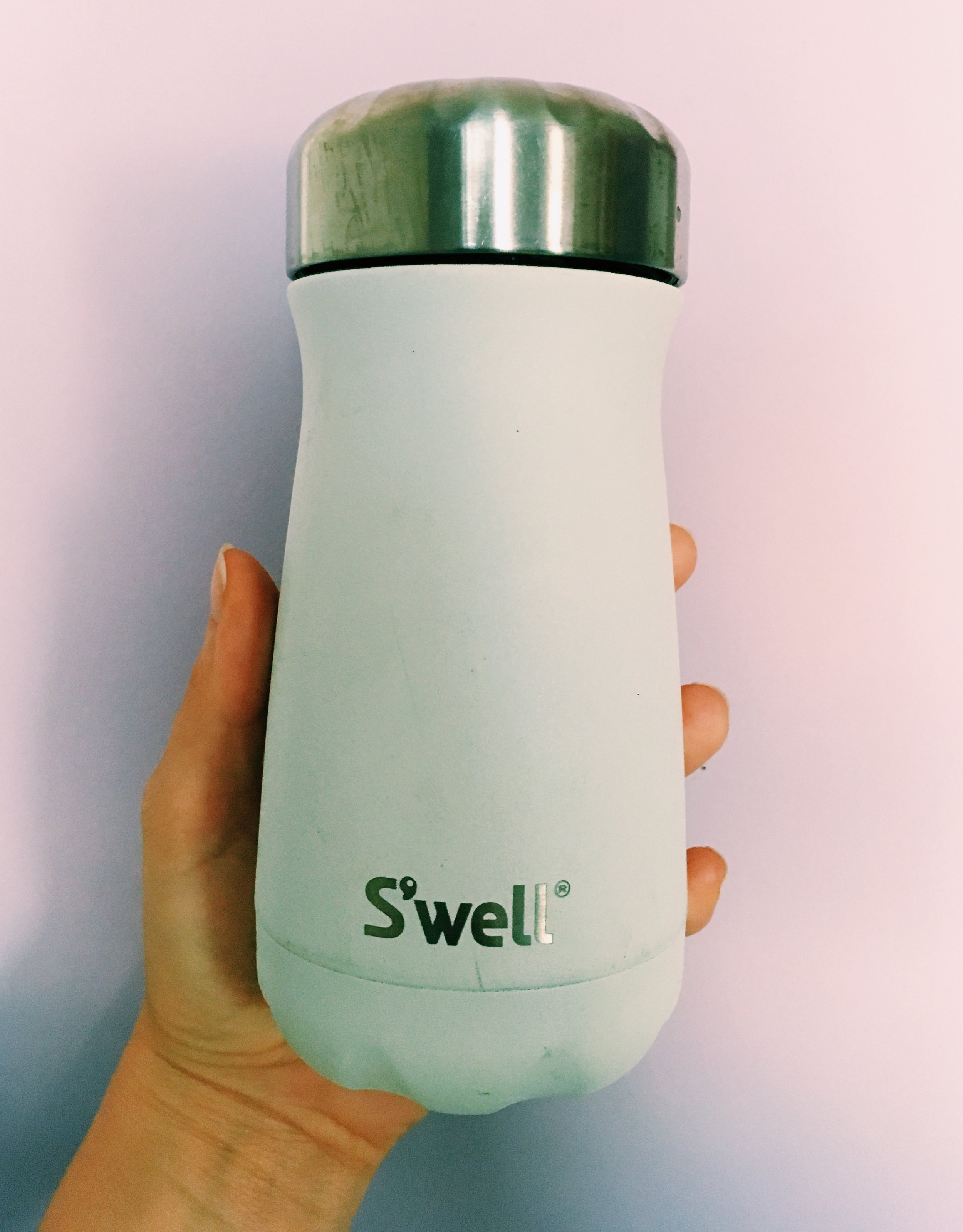 Travel Mug - I gave up on a travel mug that you could sip from the top and trust putting in your bag without it leaking.Click Here