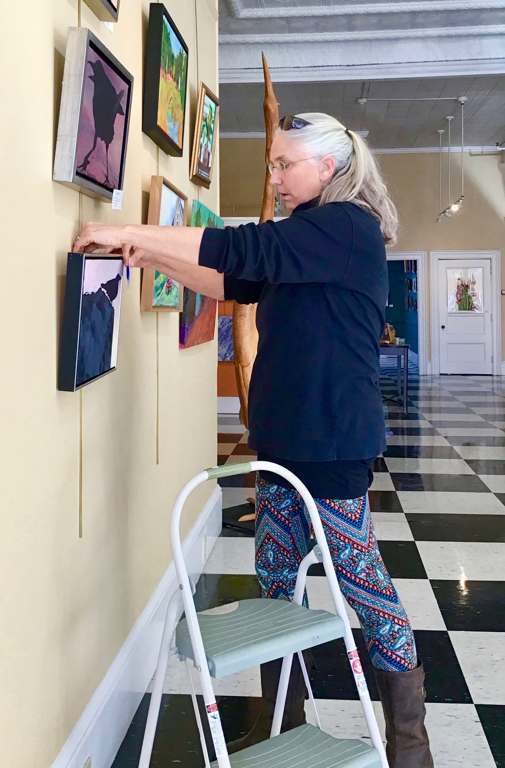 Laurie is hanging her new paintings!