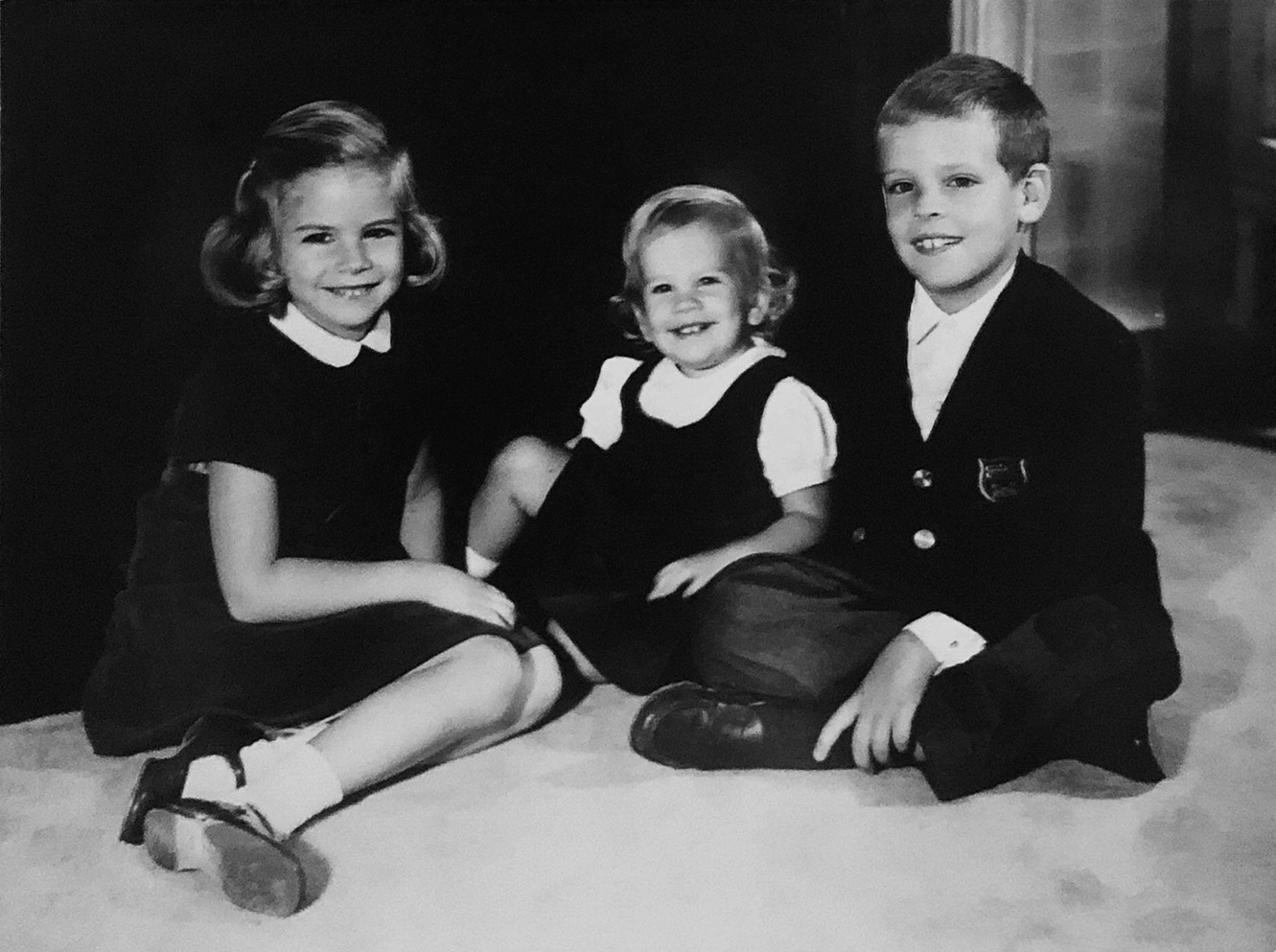 Rocky, age six, seated to the right of sisters Gail and Karey.