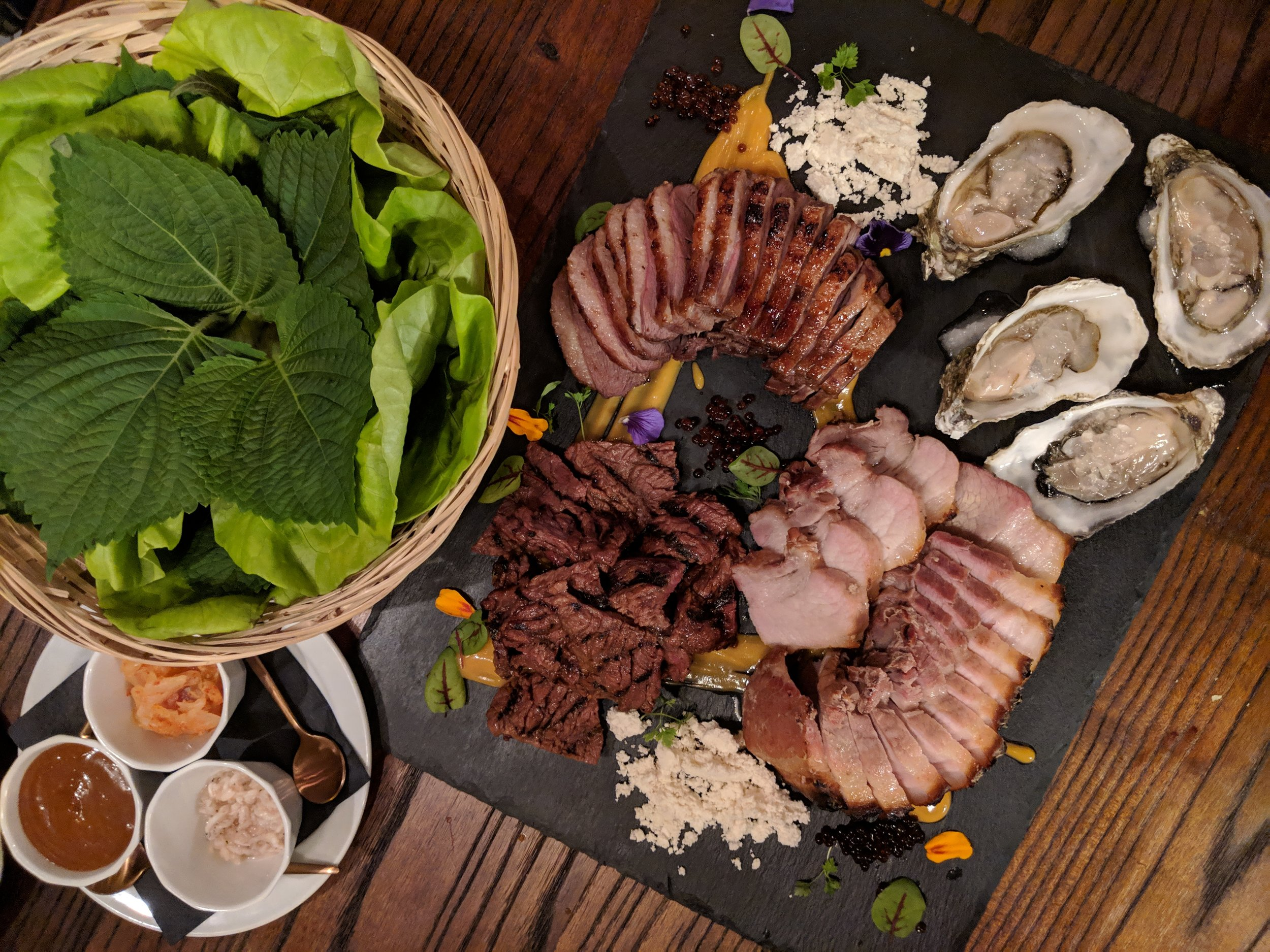 Aniq's SSAM Platter with Duck Breast, Pork Belly, Kalbi, Oysters