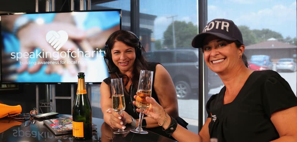 Speaking of Charity Founder Gloria Morris and Co-Host Jenifer Vargo Okamura celebrate one year and over 20 episodes with a champagne toast on the set at WJOB!