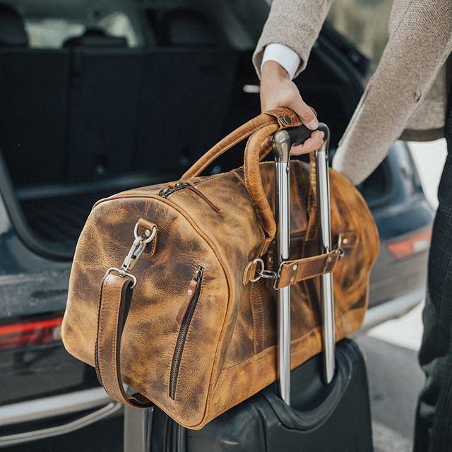 Our 45L Denali Duffel Kickstarter campaign is LIVE!! Designed for easy airline travel this bag takes the hassle out of going through security and hauling luggage around the airport ✈️ Pledge today to take advantage of our Super Early Bird pricing 🙌 Link in bio. 📸: @mike.biggins 👨🏻💼: @caryallendecker . . . #kickstarter #leathertravelbag #leatherduffel #leatherluggage #ruggedleathergoods #kodiakleather #kodiakleatherco #denali #denaliduffel #kickstartercampaign #crowdfunding
