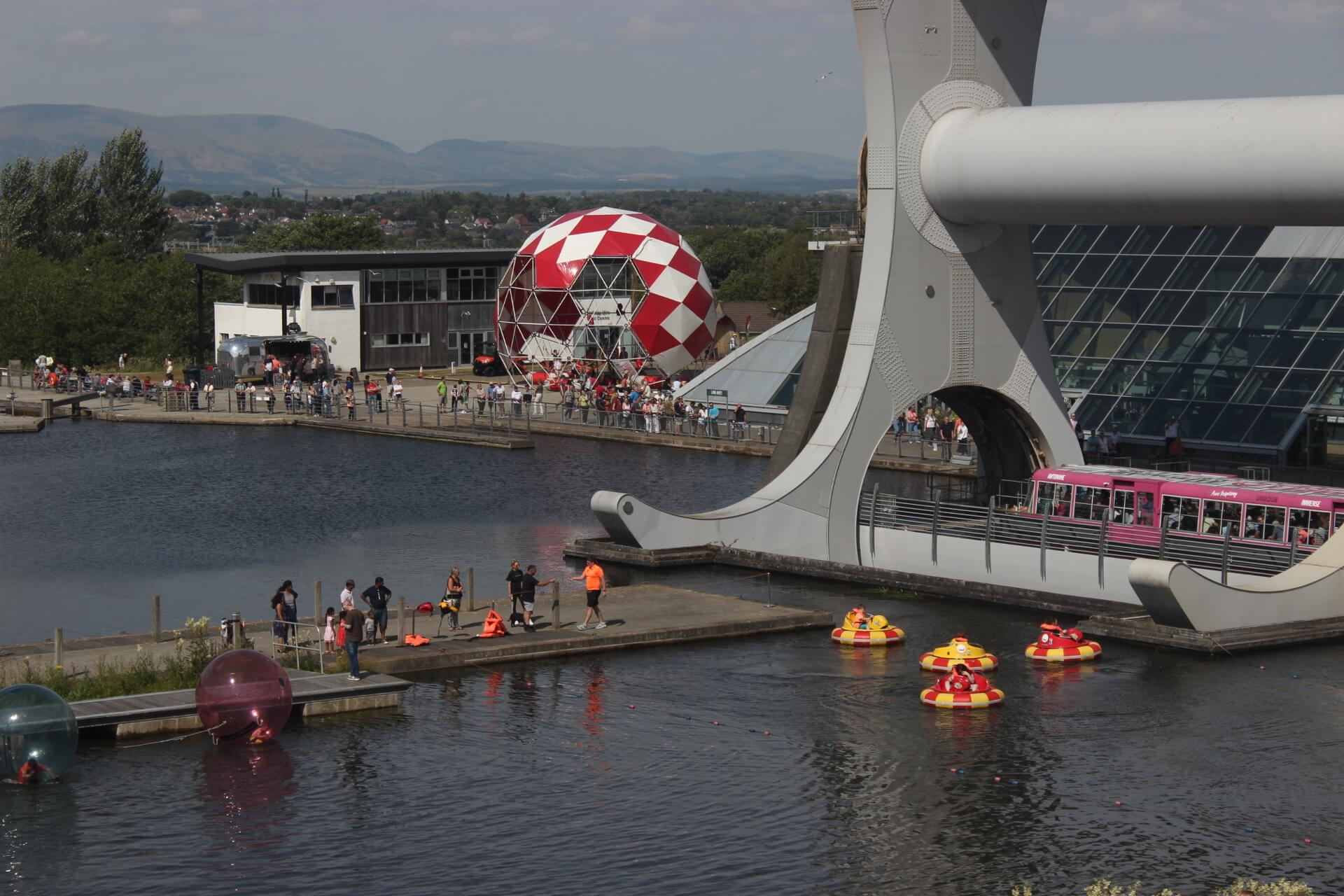 Falkirk Wheel   bubbleparc_Falkirk showcases the bungydome in its brightest red and white coat, performing in front of the awe inspiring and world famous Falkirk Wheel.