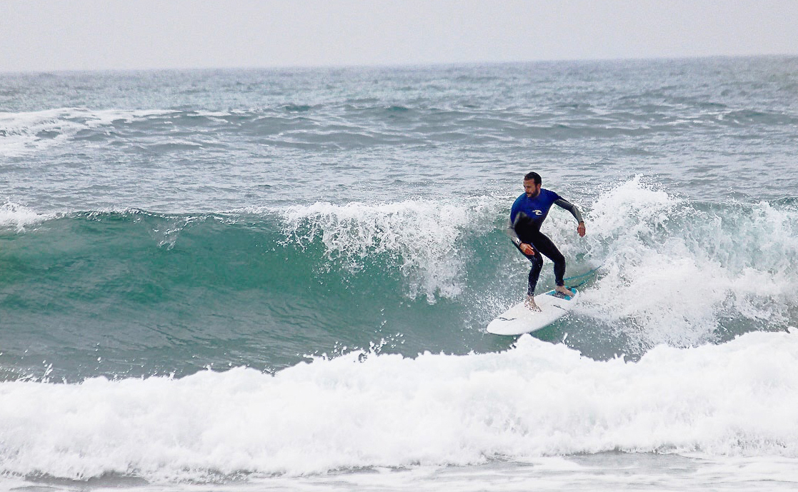 Me, very happy, on a wave. From a recent surf trip to Portugal
