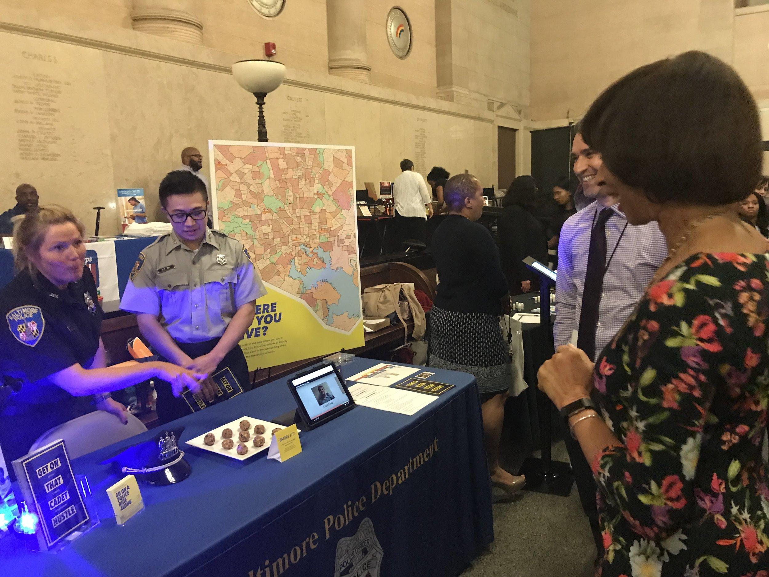 Mayor Pugh visits the cadets at BPD's recruitment table at the May 9th High School Job Fair