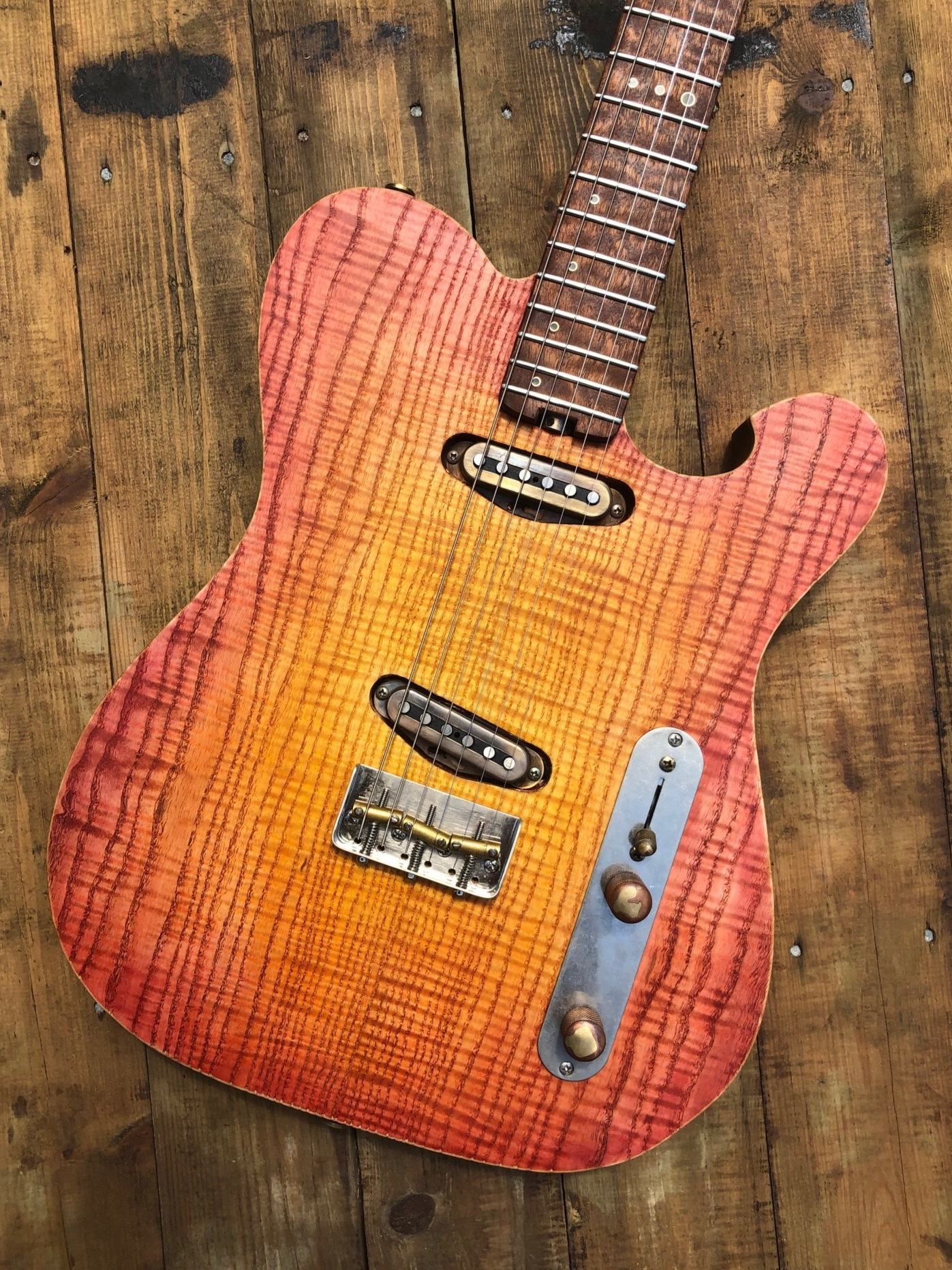 Custom built RAM t-type - Elm Solid body with an figured Ash topCherry neck quilted Sapele fret boardFuente hand wound single coil pickupsThrough body bridgeSpurzel locking tunersCTS potentiometersOrange drop capacitor