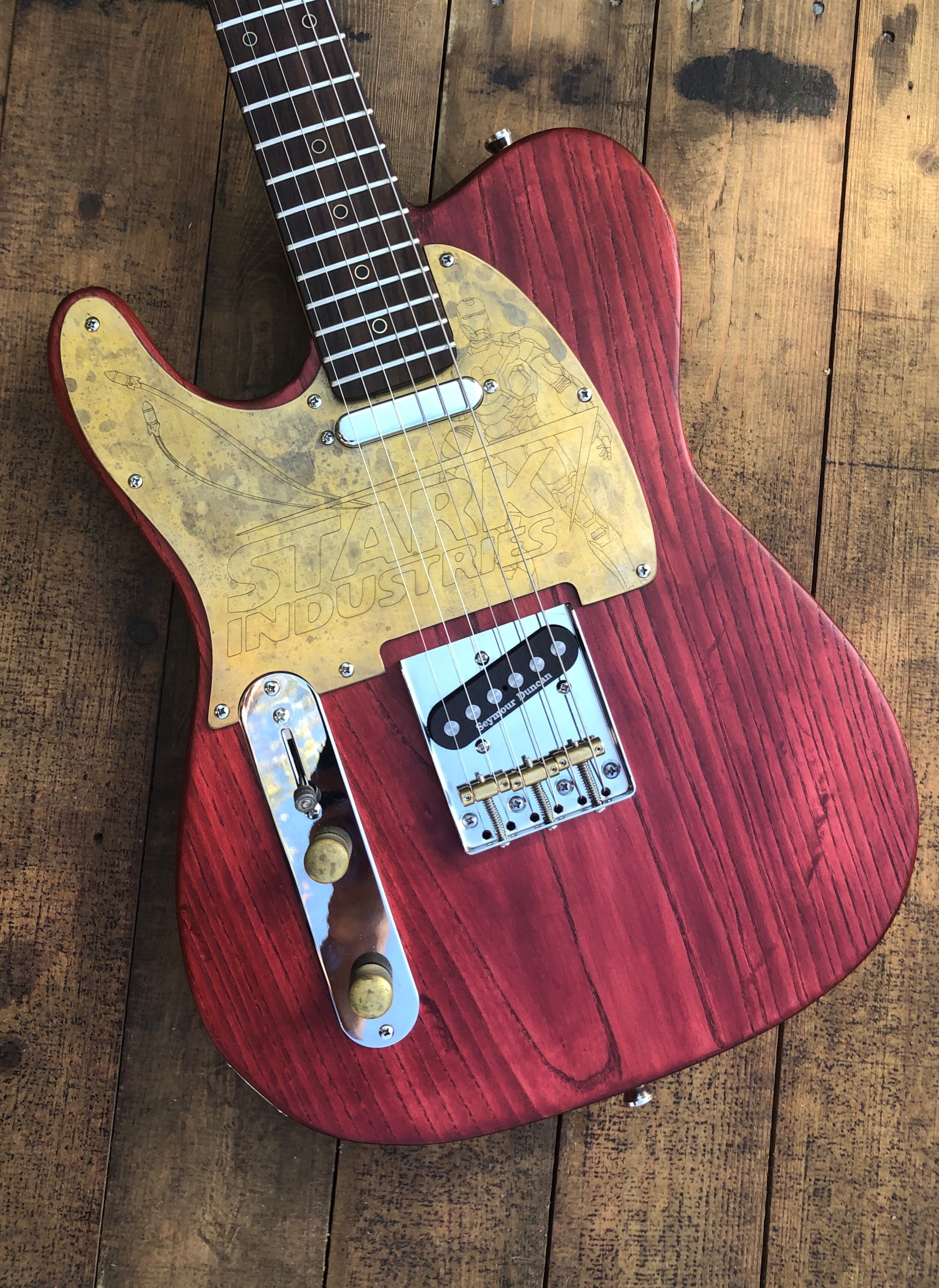 Left handed refurbed t-type - Two piece refurbed Ash Solid bodyFlamed maple neck Rosewood fret boardSeymour Duncan 1/4 pounder pickupsChrome through body bridgeCustom Brass hardwareAlpha potentiometersTropical Fish capacitor