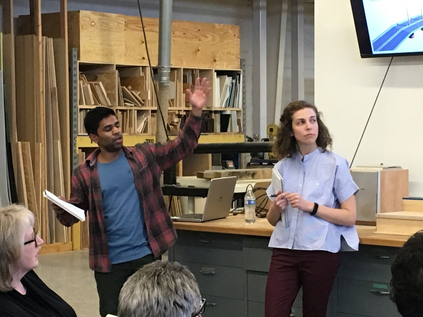 Georgia Tech students Amrith Nair (MS CEE) and Emily Wirt (M ARCH) present their design ideas to the Re-Wind visiting team