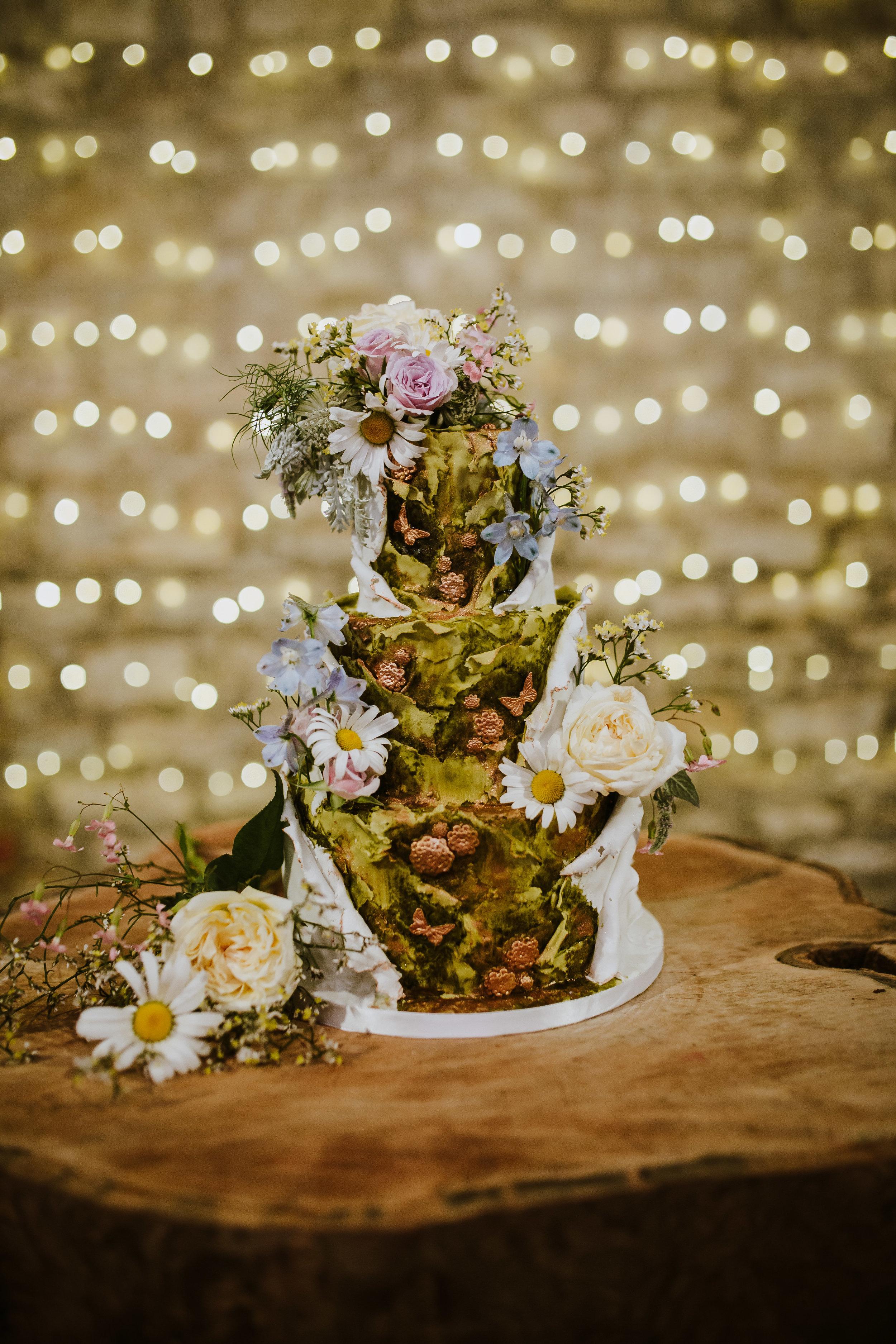 Whimsical secret garden wedding cake