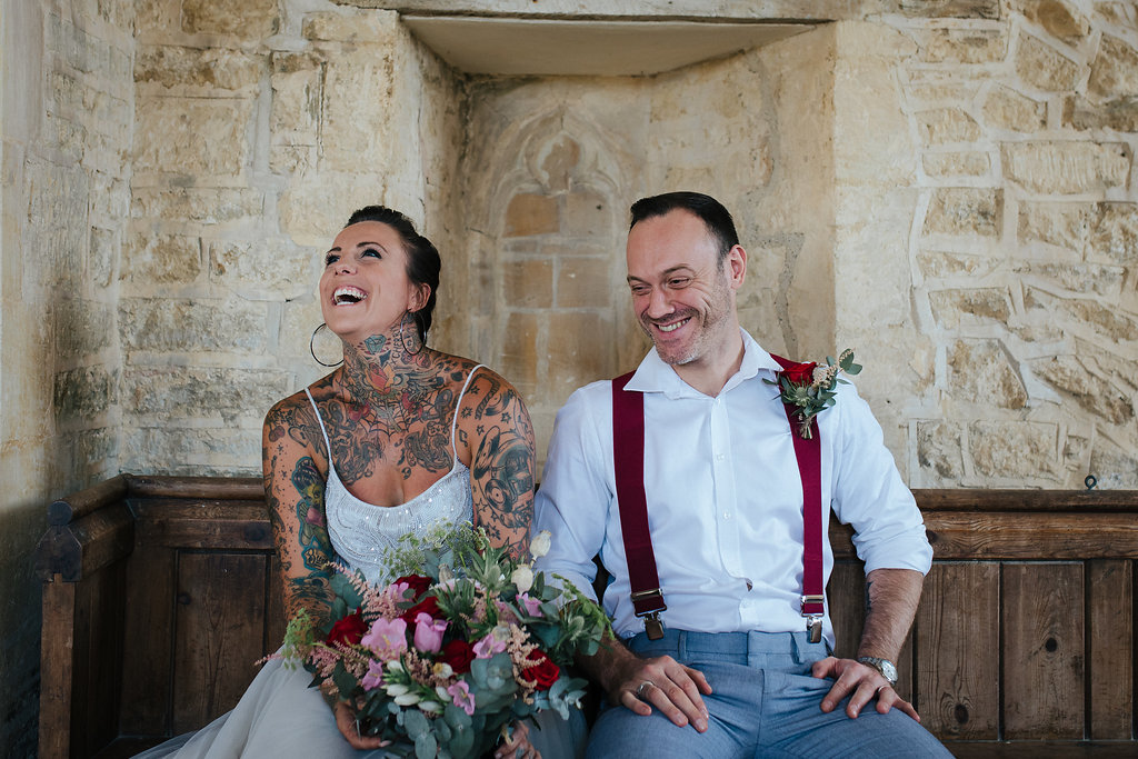 Rock and roll bride and groom laughing