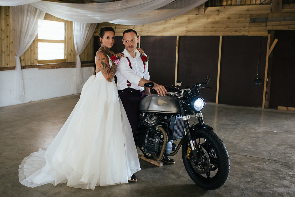 Bride and groom on vintage motorbike