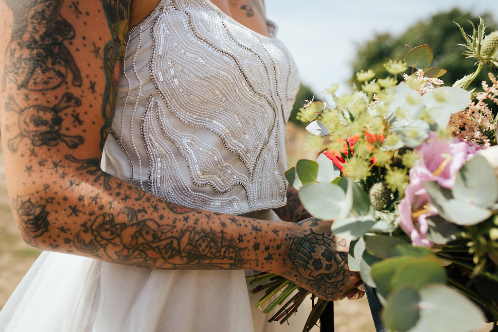 Tattooed bride and wedding bouquet
