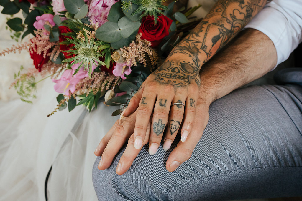 Tattooed bride wedding ring