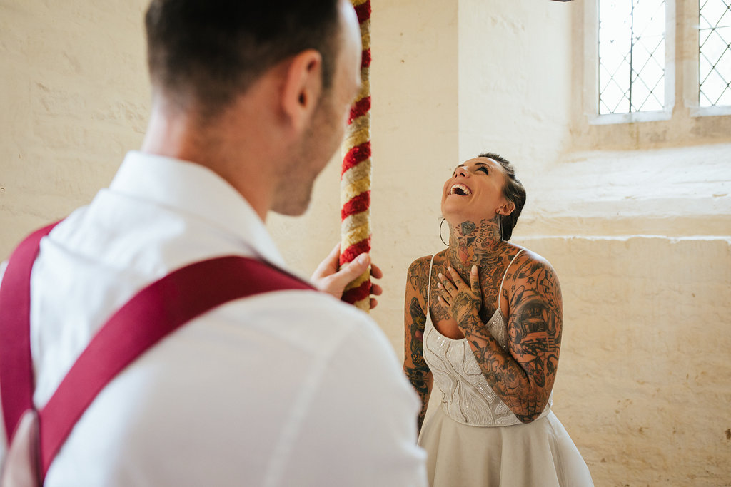 Tattooed bride and groom bell ringing