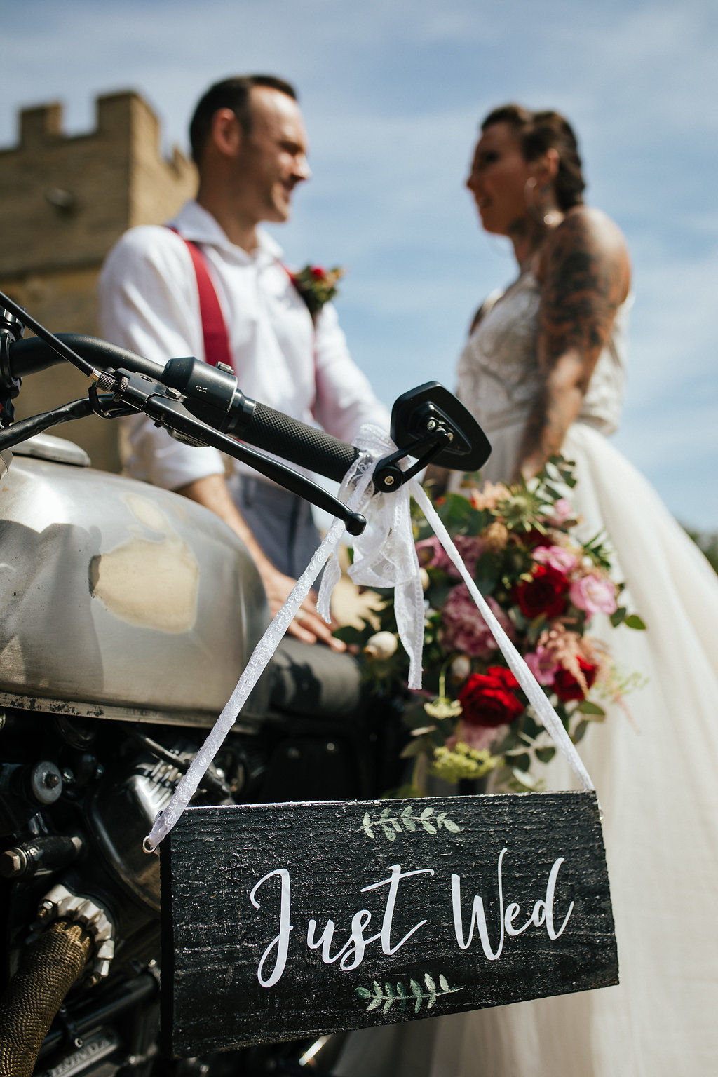Just married sign on vintage motorbike