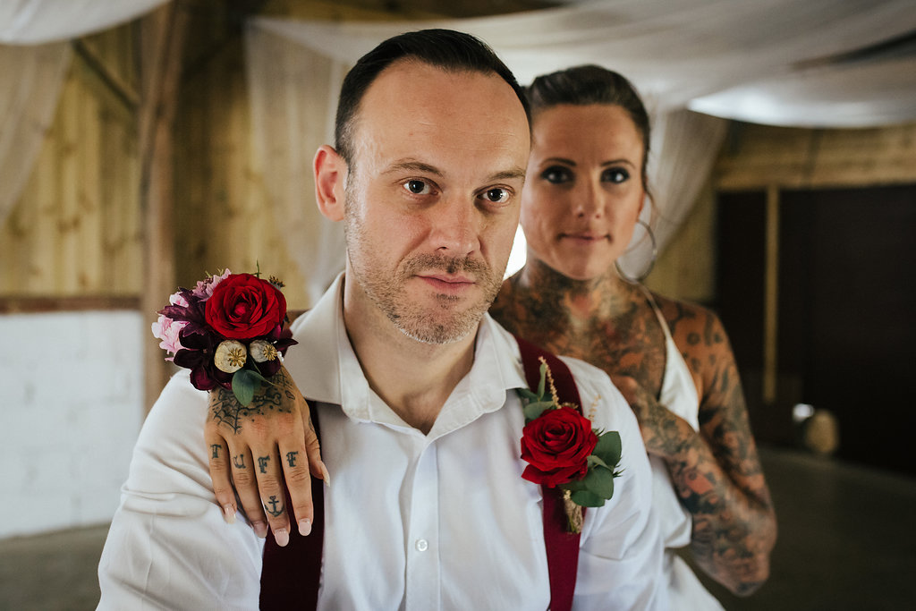 Tattooed bride and groom on motorbike