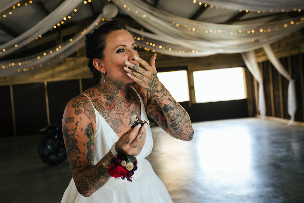 Tattooed bride eating wedding cake