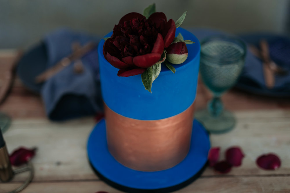 Cobalt blue and copper metallic wedding cake