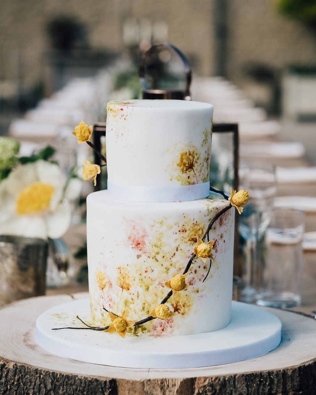 Hand painted yellow wildflower wedding cake