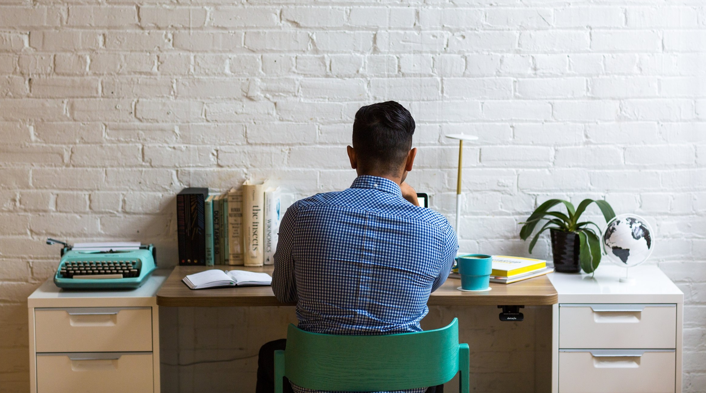 negative-space-man-working-desk-office-minimal-white-burst.jpg