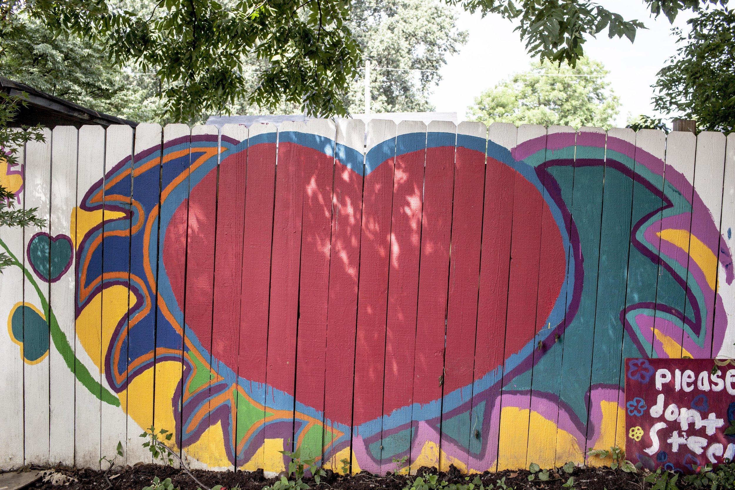The Art Garden's back fence designed by Founding Member, Brianna