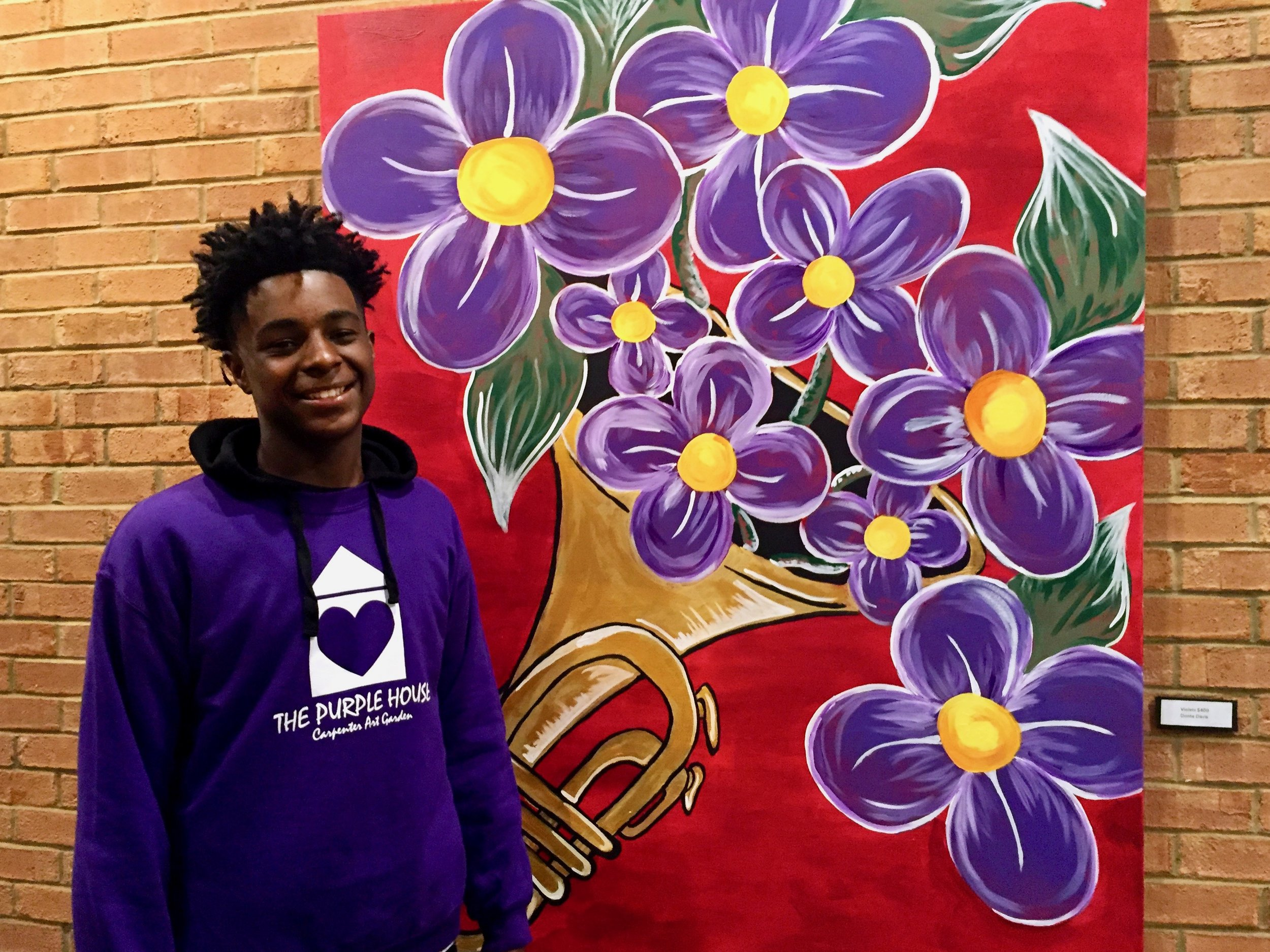 donte-staonding-in-front-of-his-painting-at-gpac 2.jpg