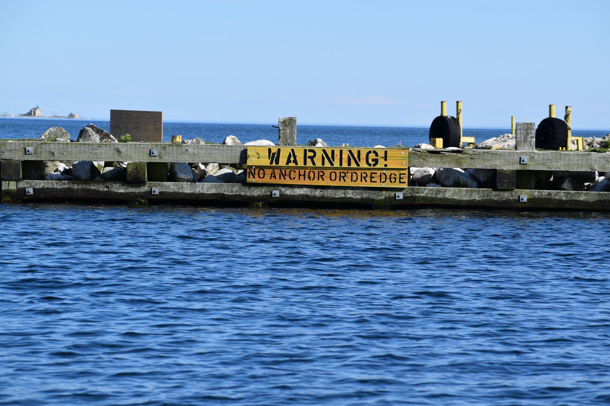 Warning Sign Plum Island Breakwall