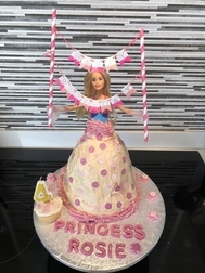 Catherine's home made princess cake for Rosie's 4th birthday was a huge success! Except for my waist line (And yes, that's a real Barbie!)