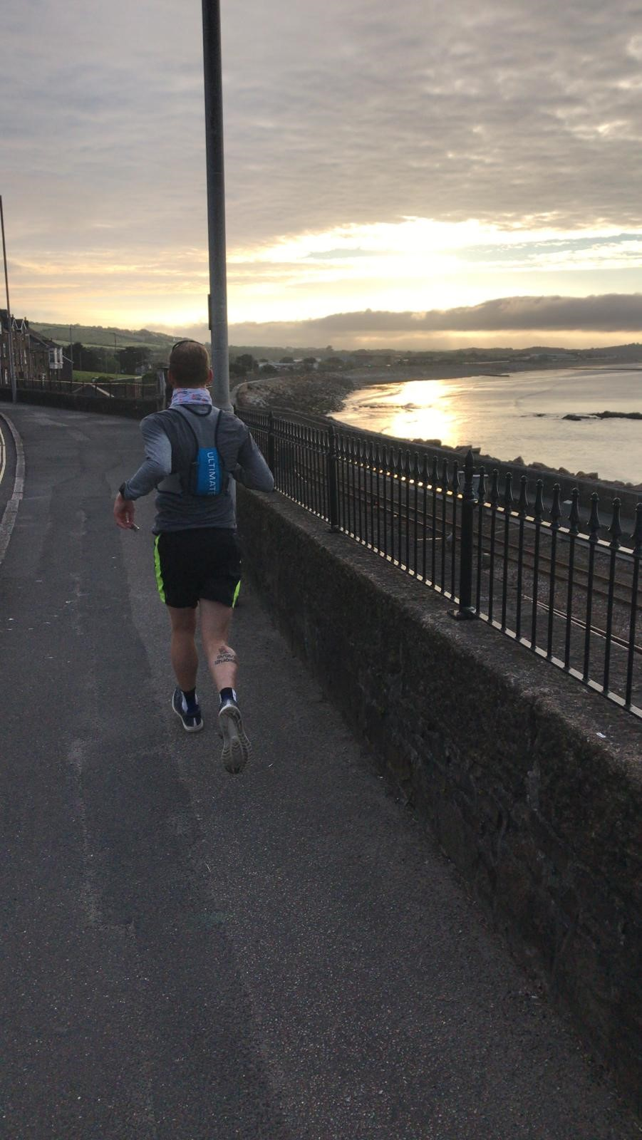 James Williams with Sunrise in Cornwall on Day 1 of LEJOG Record Attempt (for JamesRunsFar.com).jpg