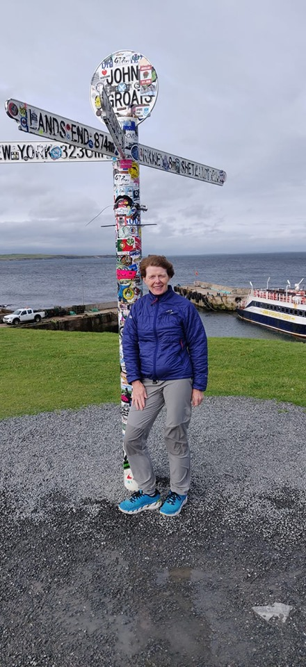 The 'Running Granny' at the start of her epic journey - The John o' Groats landpost in Scotland - Photo by Joe Bowman