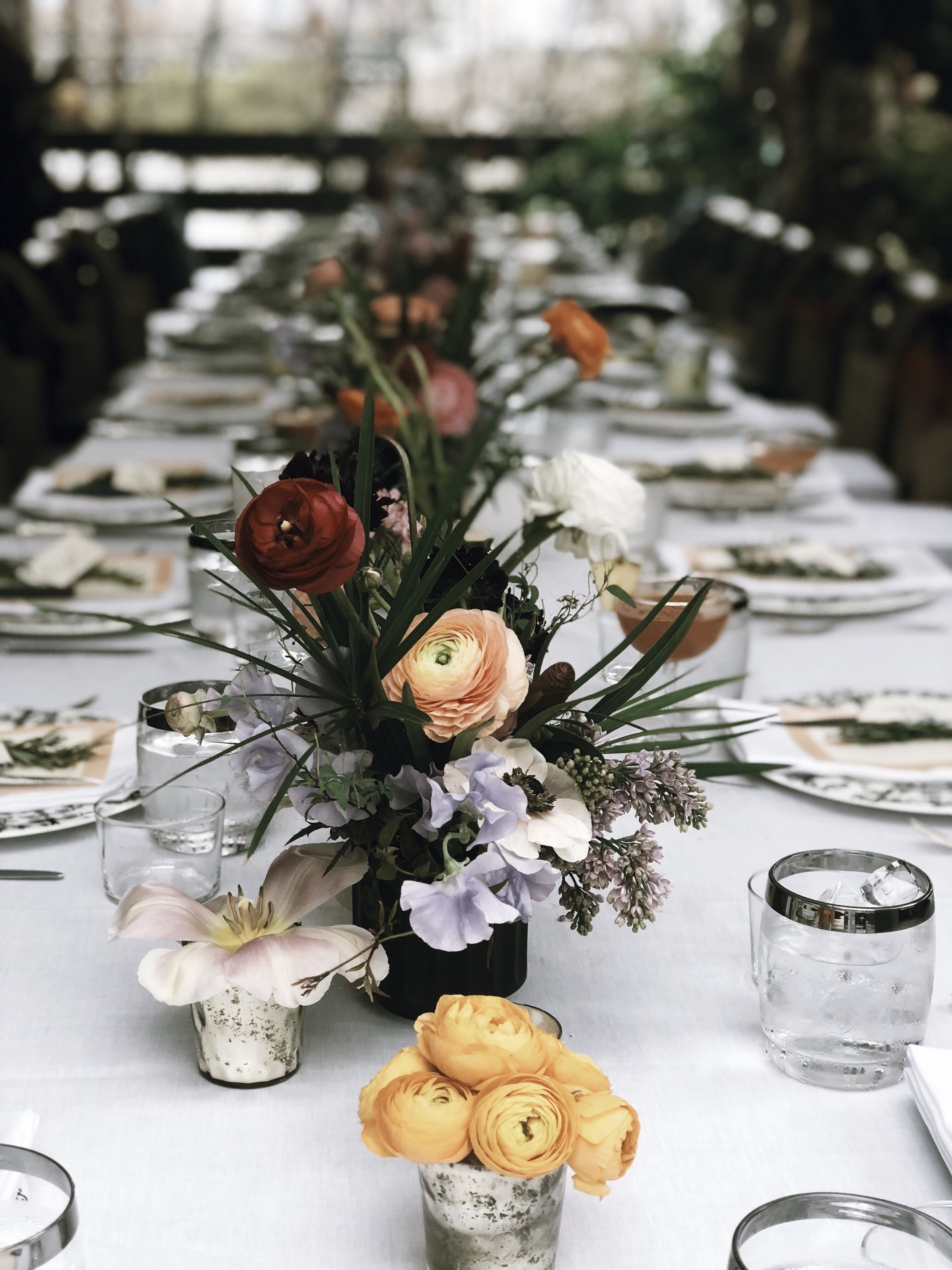Patricio of Twelve Thirty Four Flowers created stunning arrangements to outfit the terrace dinner tablescape.